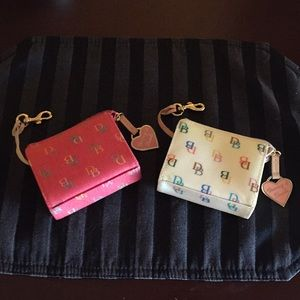 Dooney and Bourke wallets in raspberry and white